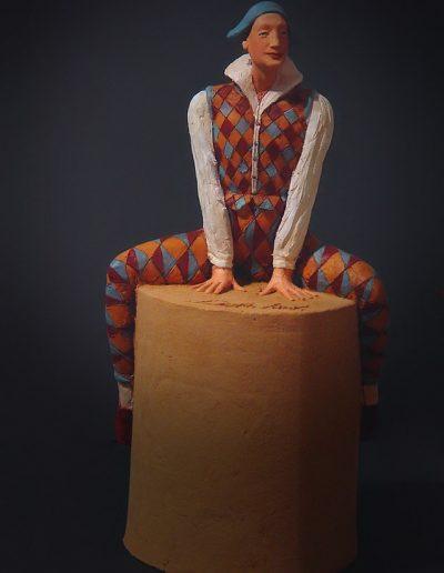 Arlecchino seduto